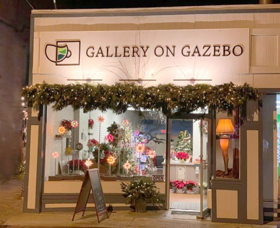 Gallery on Gazebo Exterior with Leg Lamp in Window