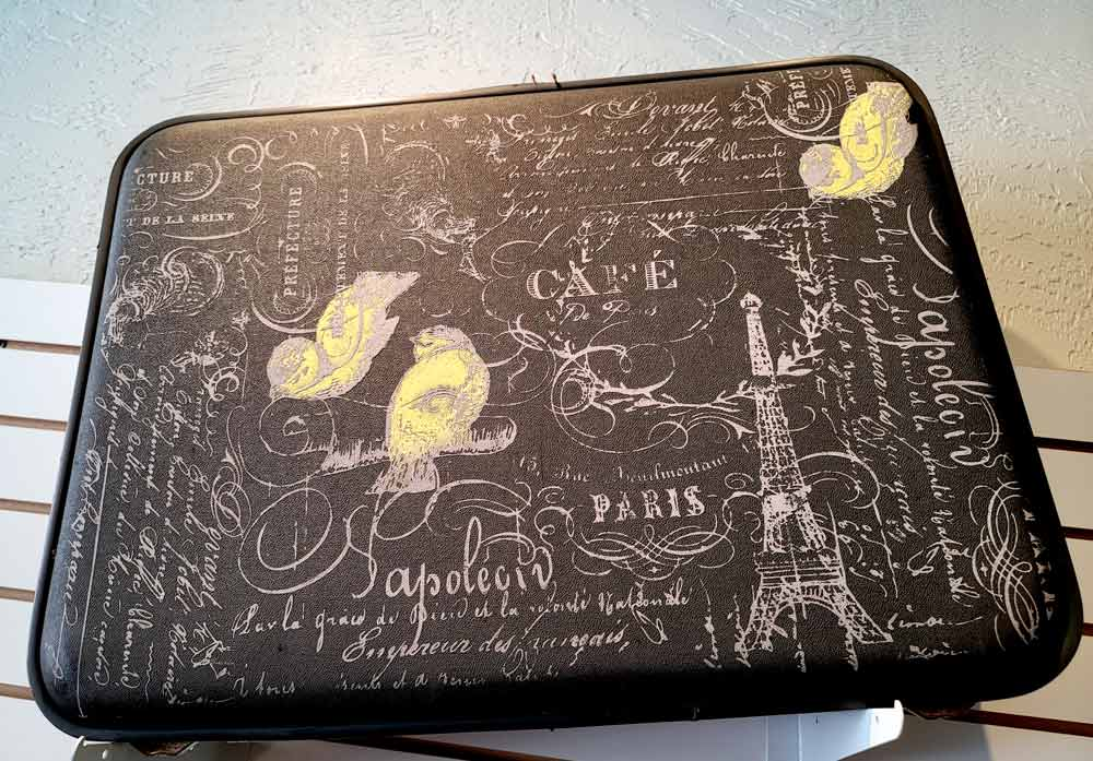French Phrases on Brown Suitcase by Erin Mosteller